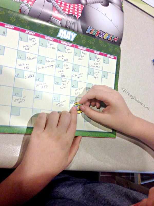 Cody using KidsWealth Calendar May_2015