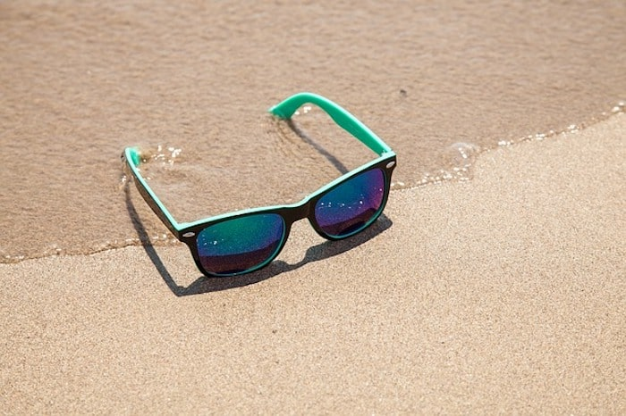 sunglasses on beach protecting your skin