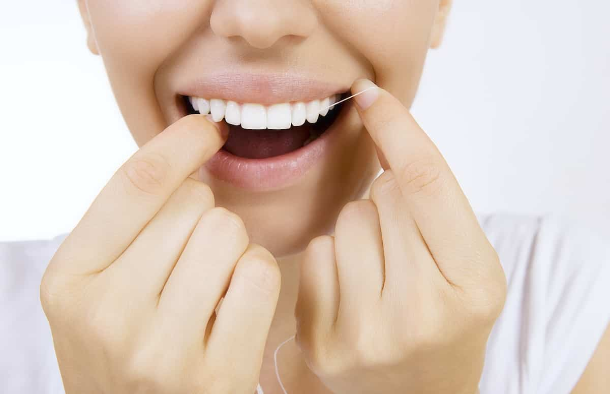 How to get the perfect smile - floss your teeth after every meal