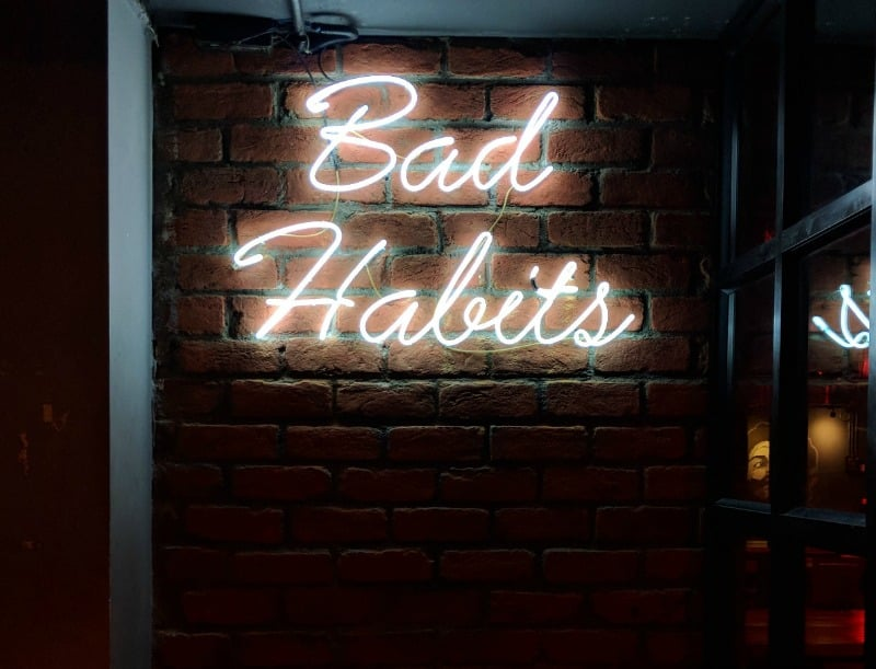 Neon bad habits sign to kick bad habits for a heart healthy life