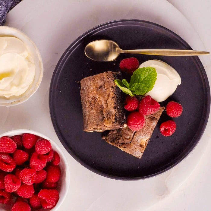 Brownies made in the Combi microwave on plate with ice cream and raspberries